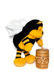 The plush bee with a honey keg. On white Royalty Free Stock Photography