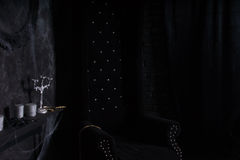 Plush Black High Back Chair in Eerie Setting Stock Photography