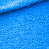 Plush blanket background. Plush blanket with rolled edge. Bright blue textured background for Spa and body care Stock Photography