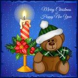 Plush Christmas bear with candle Stock Image