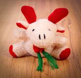 Plush Christmas reindeer on wooden background Royalty Free Stock Image