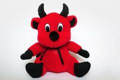 Plush devil. Plush toy red devil with horns Stock Photo