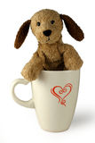 Plush dog in cup. Coffee dog soft-toy in an, I love coffee, mug with white background Royalty Free Stock Photos