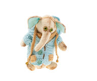 Plush elephant in a knitted jacket Stock Photo