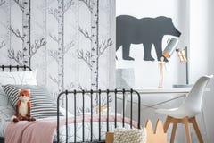 Plush fox on kid`s bed royalty free stock photos