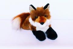 Plush fox lying stock photo