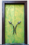 Plush green door with his hands Stock Images