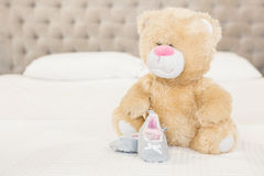 Plush and infant shoes Royalty Free Stock Images