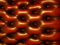 Plush Leather Horizontal 2. The back of a red, plush leather Chesterfield chair as found in gentlemen's clubs Stock Image