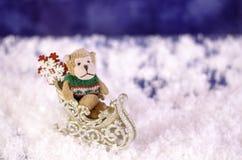 Plush monkey in a sleigh. Stock Photo