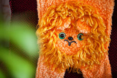 Plush orange lion of the USSR. Hanging on the back of the chair Royalty Free Stock Image