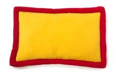 Plush pillow. Yellow - red plush pillow isolated on white Stock Photos