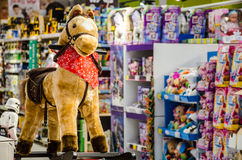 Plush pony waiting to be taken home for Christmas. In a toys store Royalty Free Stock Images