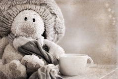 Plush rabbit and cup of tea Stock Images