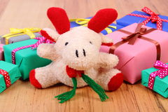 Plush reindeer with colorful gifts for Christmas or other celebration Stock Images
