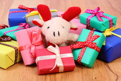 Plush reindeer with colorful gifts for Christmas or other celebration Royalty Free Stock Photo
