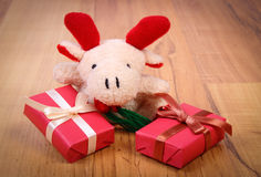 Plush reindeer with colorful gifts for Christmas or other celebration Stock Photo