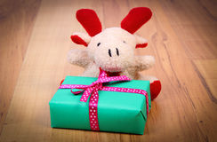 Plush reindeer with gift for Christmas or other celebration Stock Image