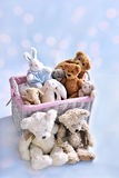 Plush teddy bears and bunnies in wicker basket Royalty Free Stock Images
