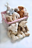 Plush teddy bears and bunnies in wicker basket Royalty Free Stock Image