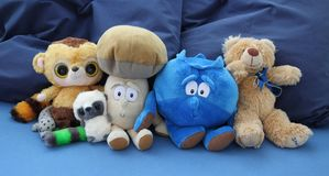 Plush teddy bears. Plush toys. Teddy bears. Blue background Stock Photos