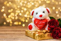 Plush toy bear, red roses and gift box. Valentines day royalty free stock photo
