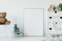 Plush toy on chair in white baby`s room interior with mockup of Stock Photos