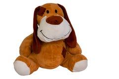 Plush toy dog isolated. Happy plush toy dog isolated on white Stock Images