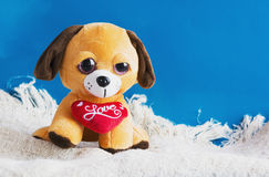 Plush toy dog with red heart Stock Photos