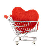 Plush toy heart in a shopping cart Royalty Free Stock Photo