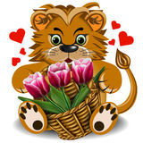 Plush toy lion with a basket of tulips Royalty Free Stock Photography