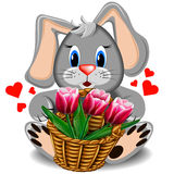 Plush toy rabbit with basket of tulips Royalty Free Stock Photos