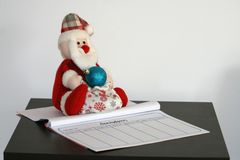 Plush toy Santa Claus and a diary stock photo