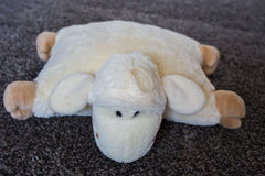 Plush toy sheep pillow. Charming dreaming sheep (plush toy). Stock Photos