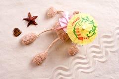 Plush toy under the beach umbrella Stock Photos