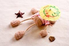 Plush toy under the beach umbrella Royalty Free Stock Image