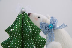 Plush white bear. With bow Christmas tree royalty free stock photo