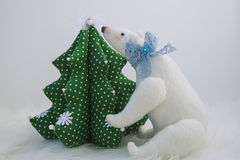 Plush white bear. With bow Christmas tree stock photography