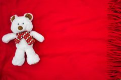 Plush white bear on a red veil. White teddy bear. Nice toy for free. Romantic symbol. Red background. Festive postcard. Happy Birthday. I love you. A declaration Stock Photo