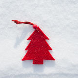 Plushy red fir tree toy on snow Royalty Free Stock Images