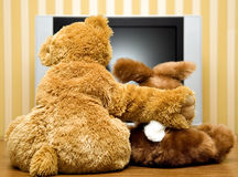 Plushy toys near lcd televisor Stock Image