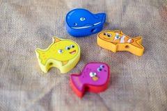 Plusieurs de poissons en bois de jouet Photo stock