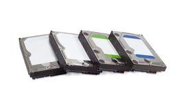 Plusieurs différents lecteurs de disque dur sur un fond blanc Image libre de droits