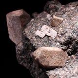 Plusieurs pierres de rhyodacite et fond noir Images stock