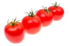 Plusieurs tomates mûres rouges d'isolement sur le fond blanc Images stock