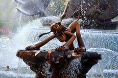 Pluto at disneyland hong kong. Bronze statue of pluto in a playful mood at disneyland, hong kong Stock Image