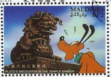 Pluto. MALDIVE ISLANDS - CIRCA 1996: stamp printed by Maldive Islands, shows Pluto encounter in the Temple Garden, circa 1996 Stock Image