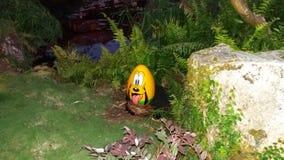 Pluto op een ei Stock Foto