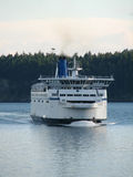 Plying the Waters. Ferry traveling the waters between Vancouver and Victoria BC royalty free stock image