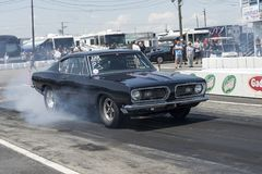 Plymouth barracuda smoke show on the track Stock Photo